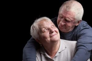 shutterstock_134464871 old couple man over shoulder